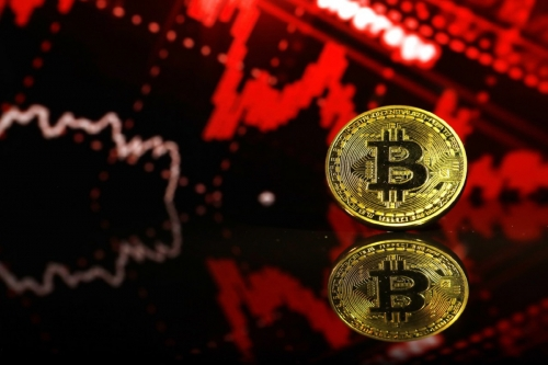 ▲비트코인 주화. 투자자들은 최근 비트코인과 증시 상관관계에 주목하기 시작했다. 블룸버그