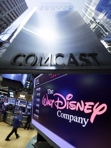 ▲컴캐스트와 월트디즈니가 21세기폭스 인수(M&A)를 놓고 경쟁하고 있다. 컴캐스트가 13일(현지시간) 폭스에 650억 달러를 제안하면서 미디어 업계가 주목하고 있다. AP연합뉴스