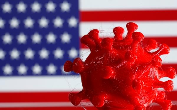 ▲3D 인쇄된 코로나바이러스 모형이 미국 국기 앞에 전시돼 있다. 로이터연합뉴스