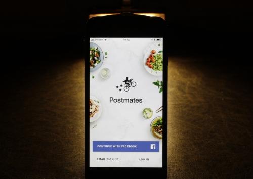 ▲애플 아이폰에 온라인 음식배달업체 포스트메이츠 앱이 표시돼 있다. AP뉴시스